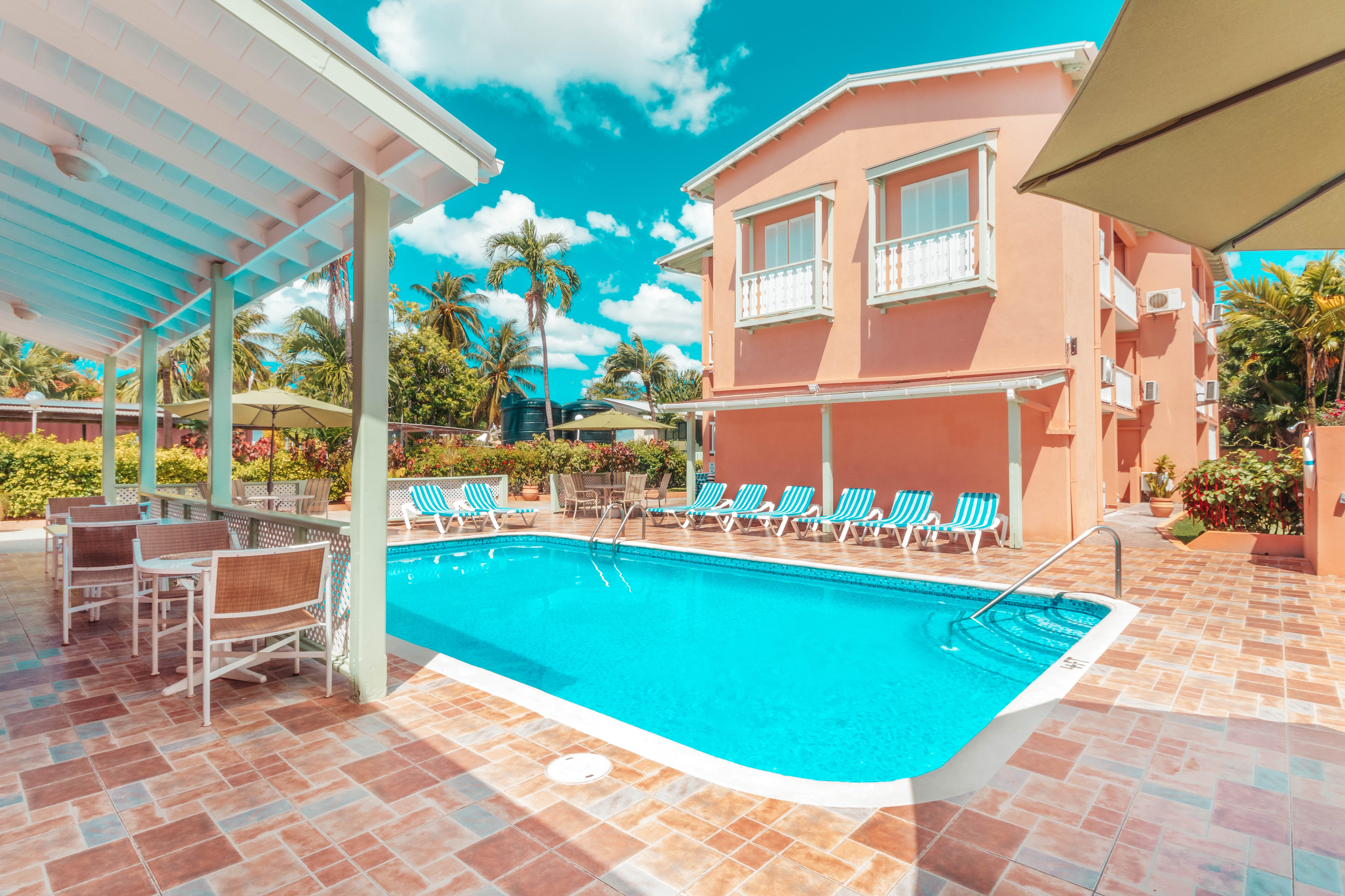 38 Residents | Worthing | Tropical Beachfront Complex w/ Coworking + Restaurant